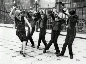 American+woman+teaching+English+boys+to+dance+the+Charleston.+Great+Britain,+1925